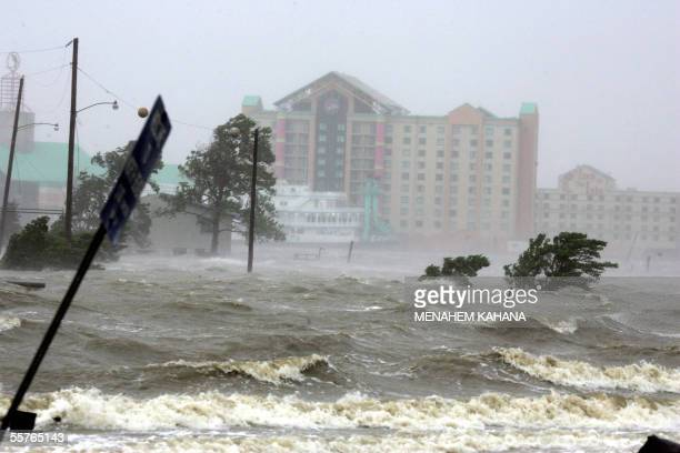 Waves crash inland on the flooded shore of Lake Charles Louisiana 24 September 2005 after hurricane Rita gave the US Gulf Coast its second pounding...