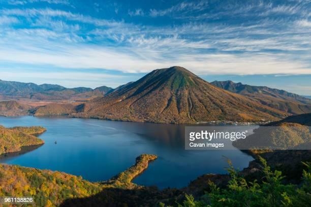 lake chuzenji by mount nantai against sky - nikko city stock pictures, royalty-free photos & images