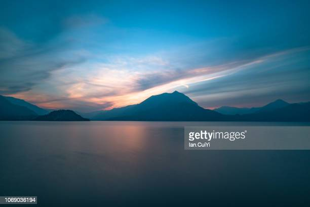 lake como, varenna, italy (dusk) - dusk stock pictures, royalty-free photos & images