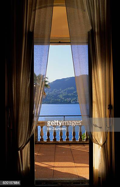 lake como view from hotel balcony - bo zaunders stock pictures, royalty-free photos & images