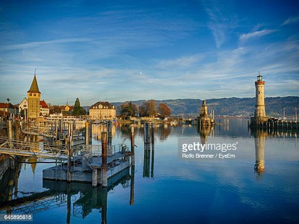 lake constance and buildings against blue sky on sunny day in city - bodensee stock pictures, royalty-free photos & images