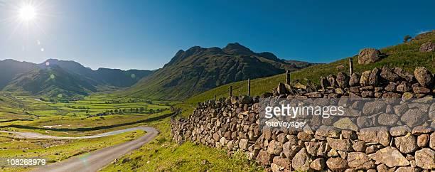 lake district dramatic sunburst idyllic landscape panorama uk - stone wall stock pictures, royalty-free photos & images