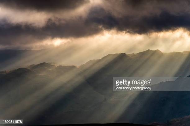 lake district light rays through a storm - sheep stock pictures, royalty-free photos & images