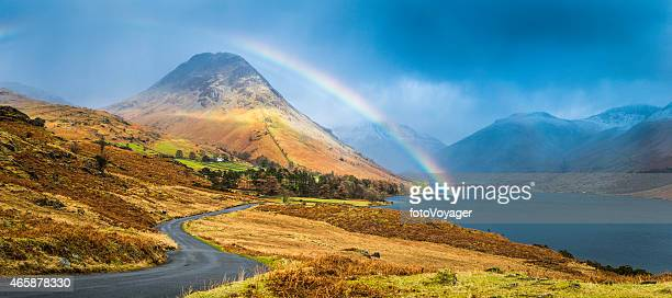 lake district rainbow over wast water western fells panorama cumbria - cumbria stock pictures, royalty-free photos & images