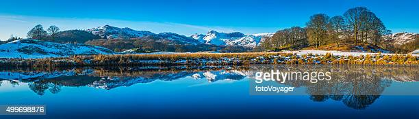 Lake District snowy Langdale mountains reflecting in Elter Water Cumbria