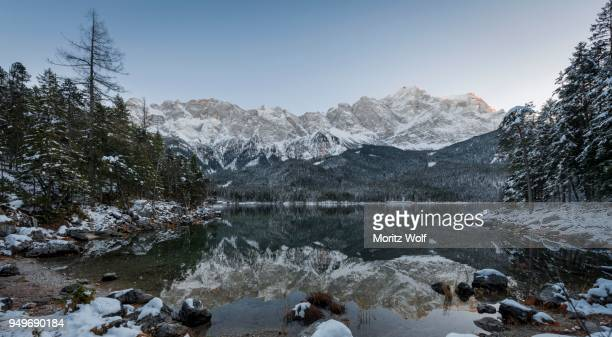 lake eibsee lake in winter with zugspitze, spiegelung, wetterstein range, upper bavaria, bavaria, germany - spiegelung stock pictures, royalty-free photos & images