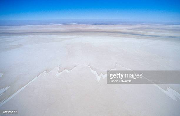 The evaporation marks staining the dry bed of a vast inland Salt Lake.