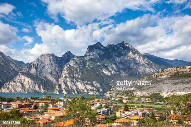 lake garda and the village of arco, trento, italy - trento foto e immagini stock