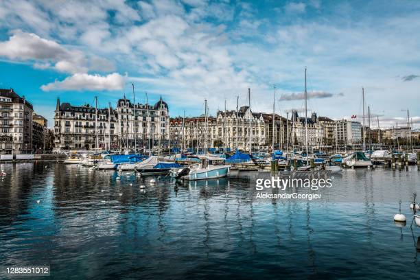 lake geneva pier and many ships on it - vaud canton stock pictures, royalty-free photos & images