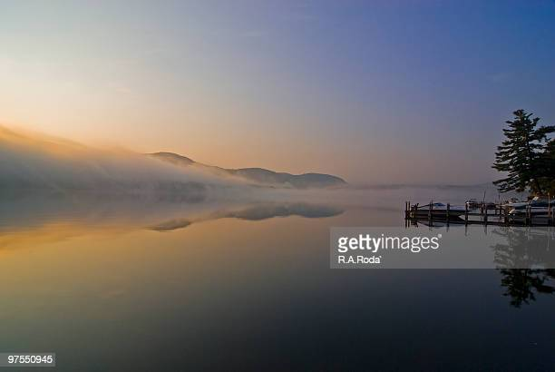 lake george sunrise with fog and boat - lake george new york stock pictures, royalty-free photos & images