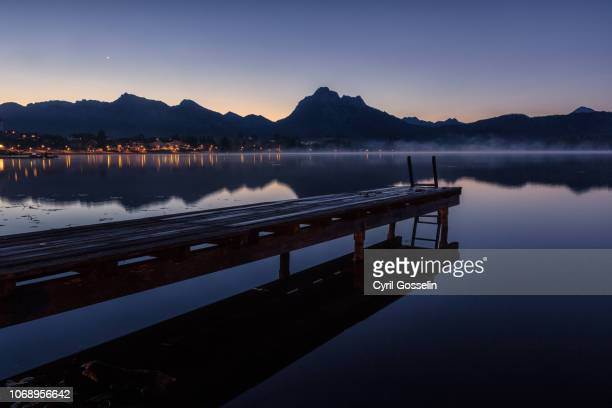 lake hopfensee and allgäu alps at twilight - bavarian alps stock pictures, royalty-free photos & images