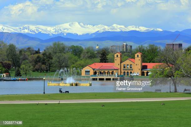 lake in front of city skyline with mountains in the background - rainer grosskopf stock pictures, royalty-free photos & images