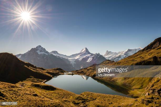 A lake in front of mountains in the Bernese Alps in Grindelward, Switzerland