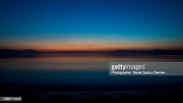lake in sunset - basak gurbuz derman stock photos and pictures