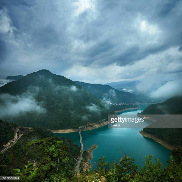 Lake in the mountains under the stormy sky