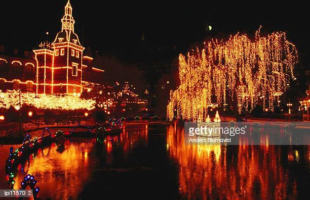 Lake in Tivoli Gardens illuminated for Christmas Market, Low angle view, Copenhagen, Denmark