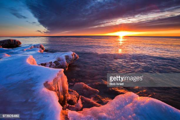 lake in winter at sunrise, milwaukee, wisconsin, usa - vilas_county,_wisconsin stock pictures, royalty-free photos & images