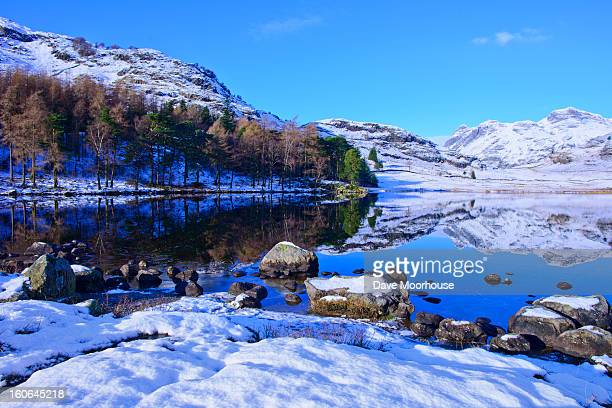 lake in winter with a mirror reflection - cumbria stock photos and pictures