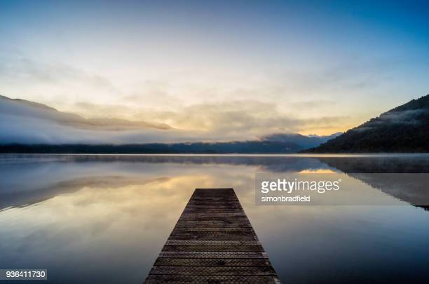 lake kaniere on new zealand's south island - jetty stock pictures, royalty-free photos & images