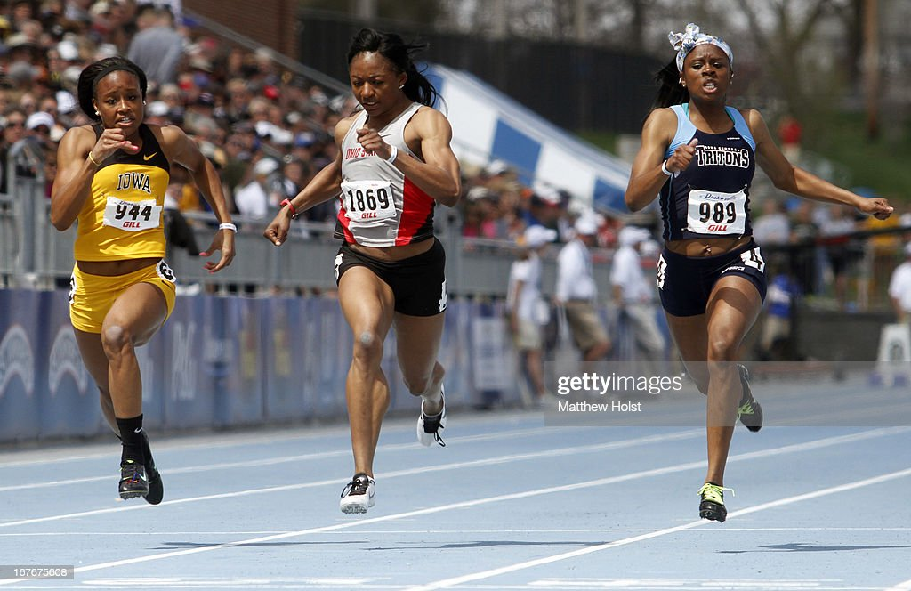 Lake Kwaza, of the Iowa Hawkeyes, Ashlee Abraham, of the Ohio State Buckeyes, and Dominique Kimpel, of the Iowa cnetral Tritons, race to the finish in the Women's 100-meter at the Drake Relays, on April 27, 2013 at Drake Stadium, in Des Moines, Iowa.