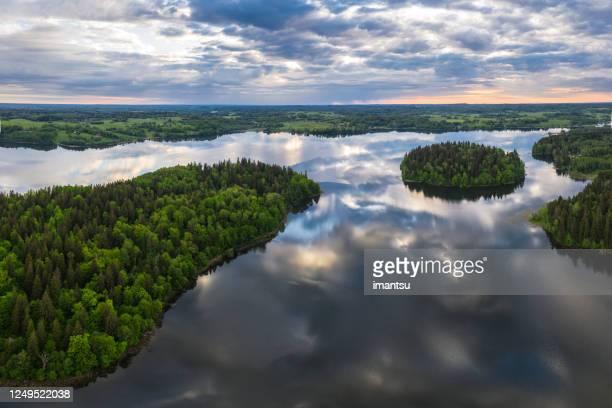 lake landscape at sunrise - latvia stock pictures, royalty-free photos & images