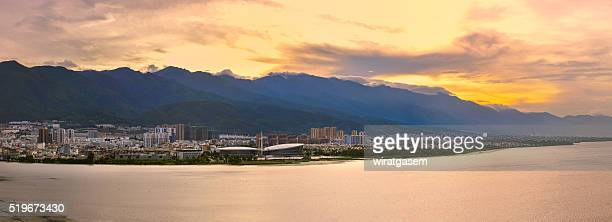 lake landscape at sunset - wiratgasem stock photos and pictures
