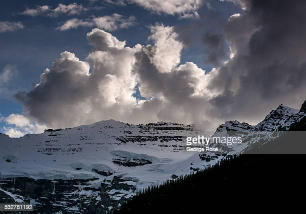 Lake Louise and surrounding mountains are still for the most part frozen in snow and ice on April 23 2016 at Lake Louise Alberta Canada Banff is...