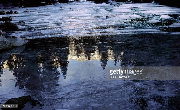 The Canadian Rockies are reflected on the Bow Valley River in the Banff National Forest 24 November 2005 in Alberta, Canada. AFP PHOTO/JEFF HAYNES