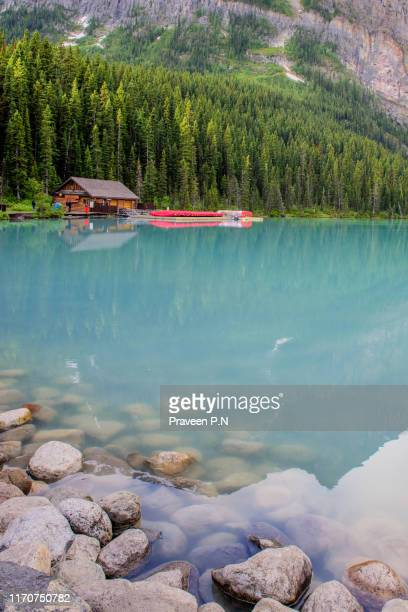 lake louise canoe dock - chateau lake louise stock photos and pictures