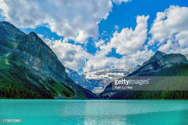 lake louise, fairview mountain, mount victoria and the beehive, banff national park, canada - lake louise lake stock pictures, royalty-free photos & images