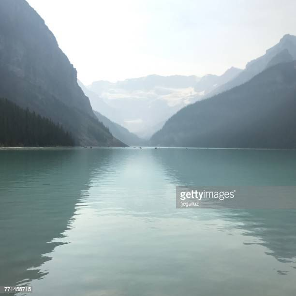 lake louise in mist, banff national park, alberta, canada - lake louise stock photos and pictures