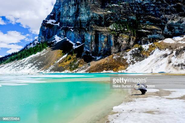 lake louise in winter, banff national park, canada - louise burton stock photos and pictures