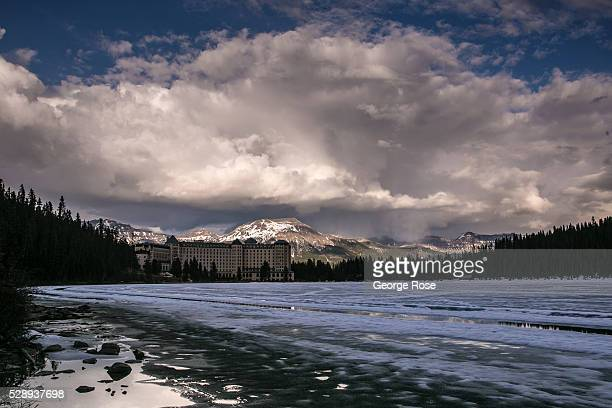 Lake Louise remains frozen over on April 23 2016 at Lake Louise Alberta Canada Banff is Canada's oldest National Park and is located in the Canadian...