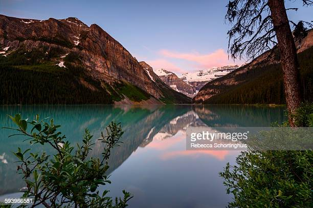 Lake Louise with pink clouds at sunrise