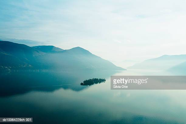 lake maggiore at sunset - ruhige szene stock-fotos und bilder