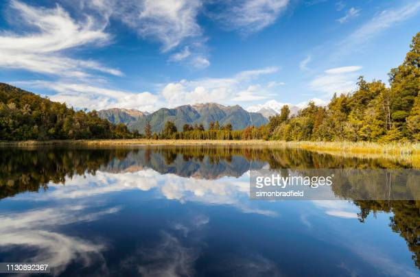lake matheson, new zealand's south island - mirror lake stock pictures, royalty-free photos & images