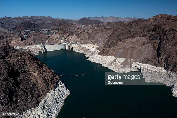 Lake Mead the Hoover Dam and the Mike O'CallaghanPat Tillman Memorial Bridge stand in this aerial photograph taken above Boulder City Nevada US on...