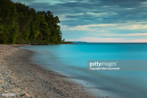lake michigan evening motion - great lakes stock pictures, royalty-free photos & images