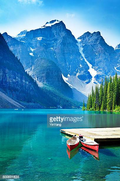 lake moraine and canoe dock in banff national park - canadian rockies stockfoto's en -beelden