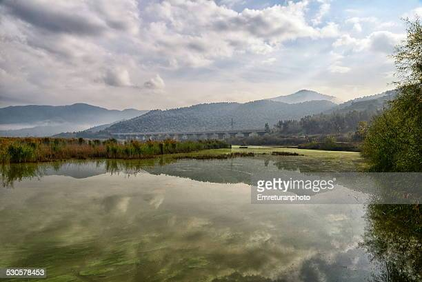 lake near highway bridge - emreturanphoto stock pictures, royalty-free photos & images