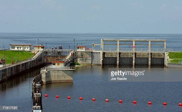 Lake Okeechobee is seen behind a lock and dam system along part of its 140milelong Herbert Hoover Dike that encircles the lake July 25 2006 in Port...