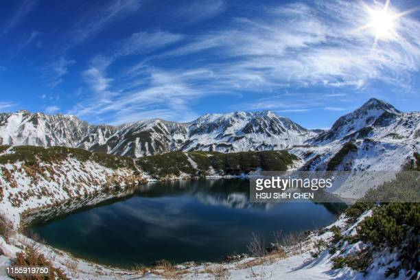 lake on the snowy mountain - land feature stock pictures, royalty-free photos & images