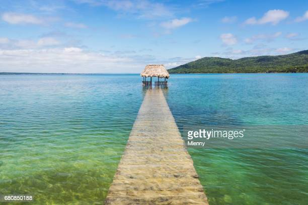 lake petén itzá flooded pier flores guatemala - guatemala stock pictures, royalty-free photos & images