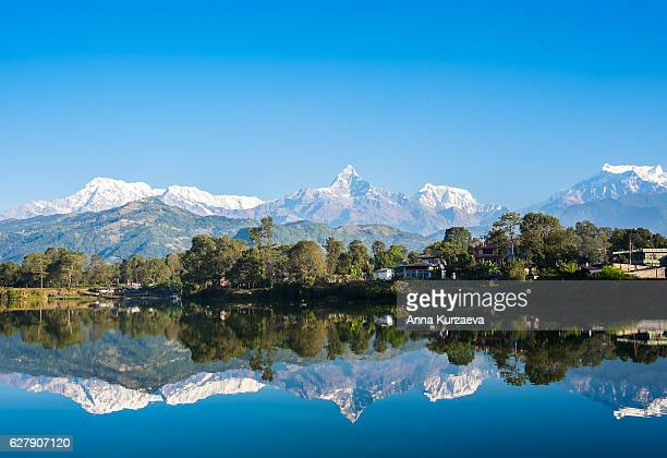 Lake Phewa in Pokhara, Nepal, with the Himalayan mountains in the background