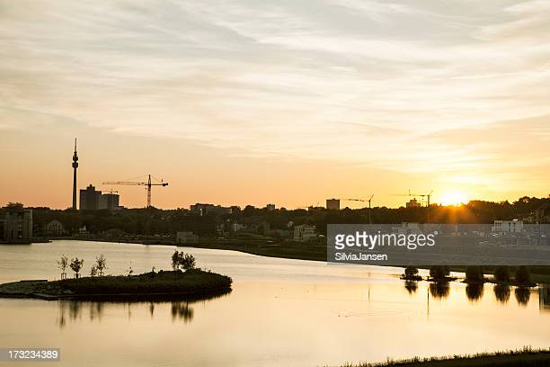 lake phoenix in dortmund, city skyline at sunset - dortmund city stock pictures, royalty-free photos & images