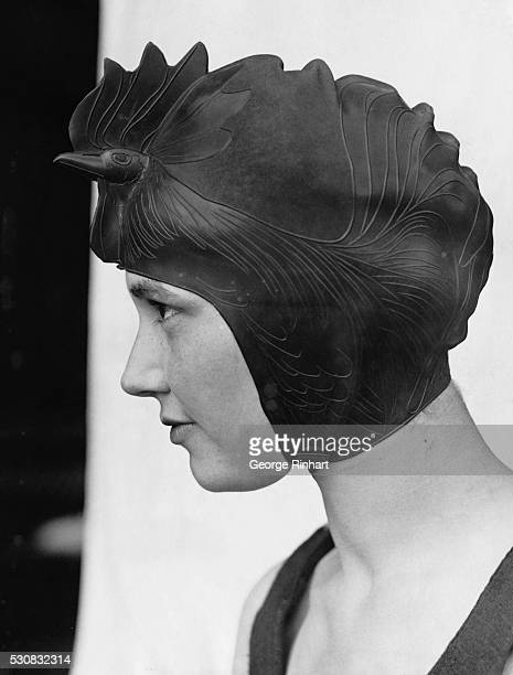 Lake Placid NY Miss Helen Mead of Washington DC and the new style swimming cap which she introduced at the Lake Placid Swimming Club Presumably one...