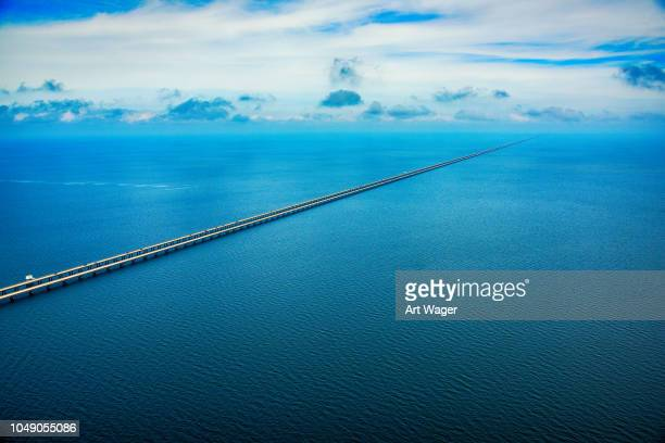 lake pontchartrain causeway aerial - louisiana stock pictures, royalty-free photos & images