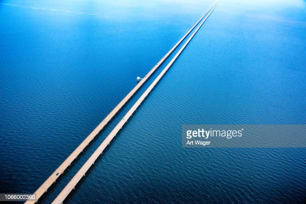 lake pontchartrain causeway aerial - vanishing point stock pictures, royalty-free photos & images