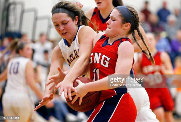 Lake Region forward Lauren Jakobs blocks GrayNew Gloucester guard Alexa Thayer as she drives to toward the basket