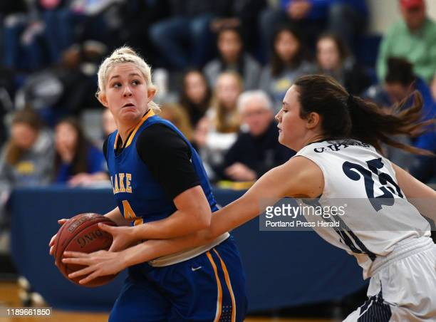 Lake Region's ShelbyLynne Sheldrick drives with the ball as Yarmouth's Kathryn Keaney plays defense Saturday Dec 14 2019